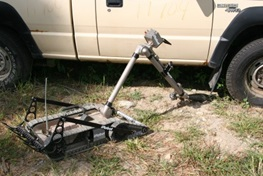 iRobot 510 PackBot examines vehicle for IEDs