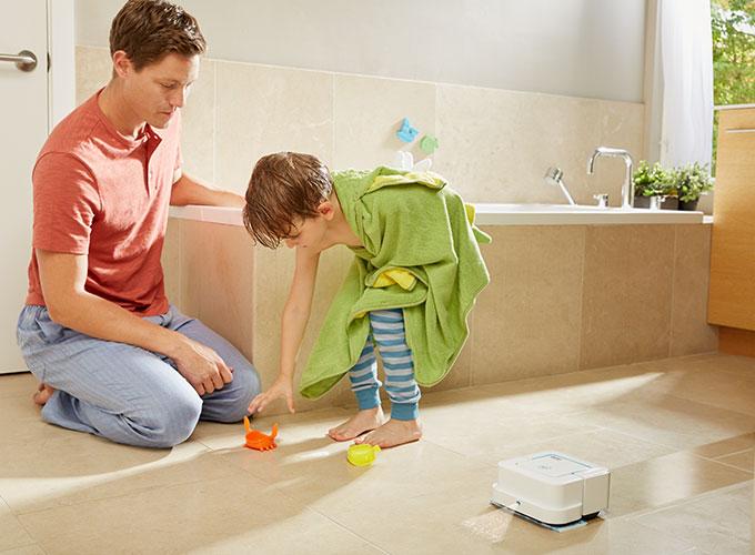 Braava jet ™ cleaning hard floor in the bathroom
